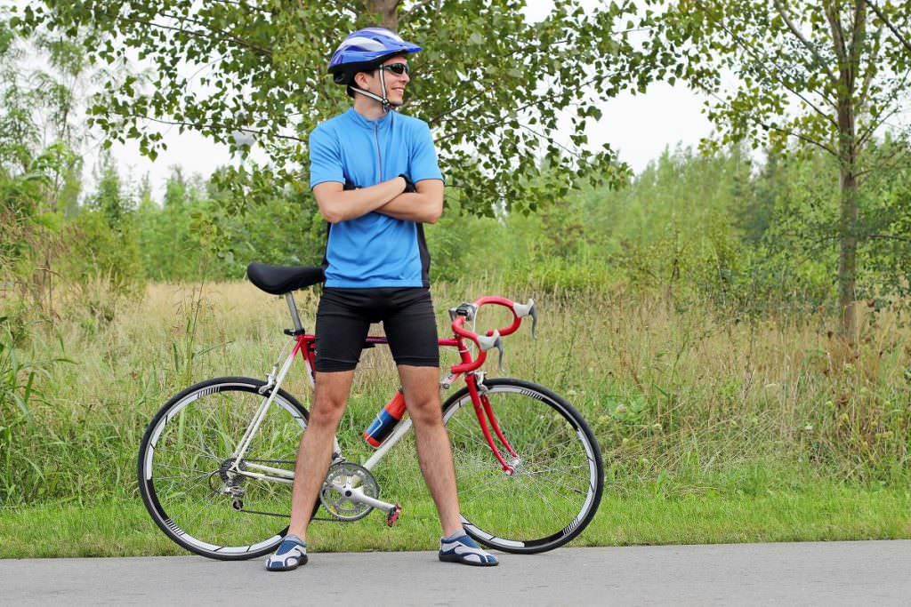 Standing next to a road bike