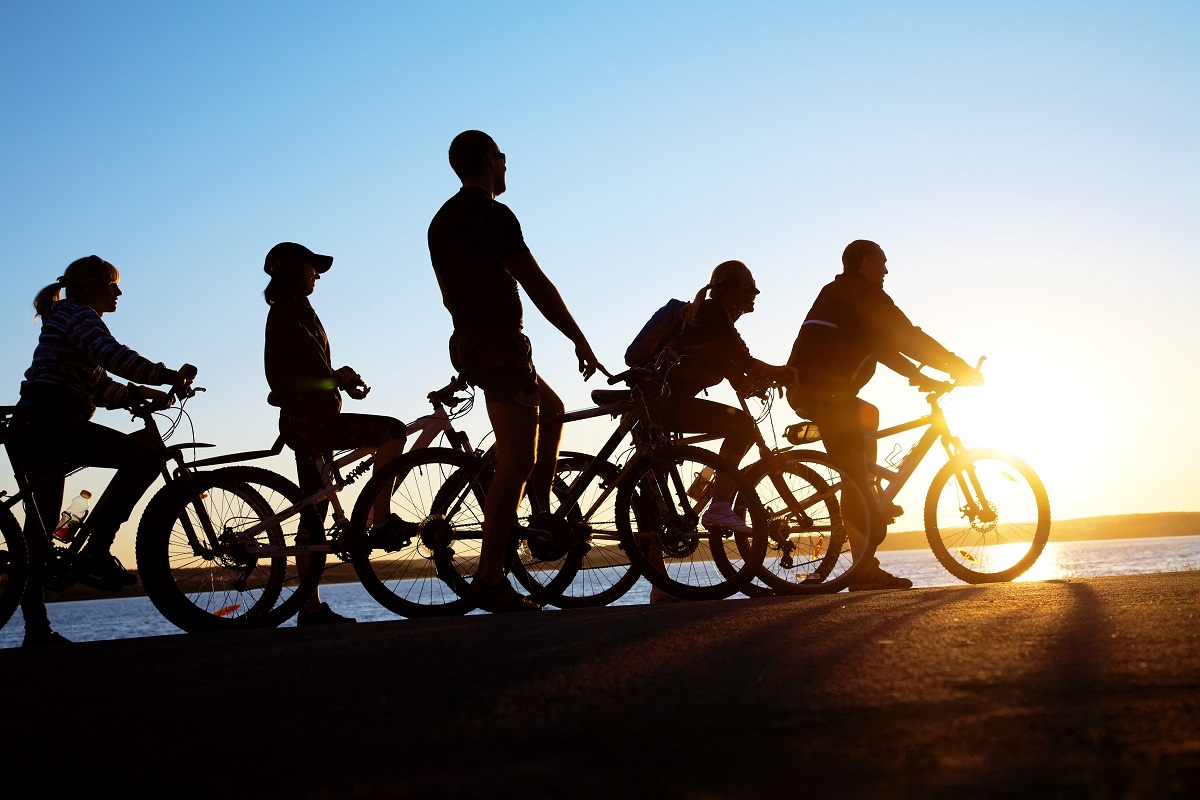 Group cycling in the sunset