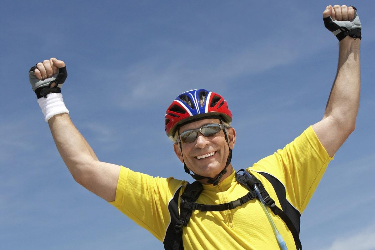 Man celebrating cycling victory