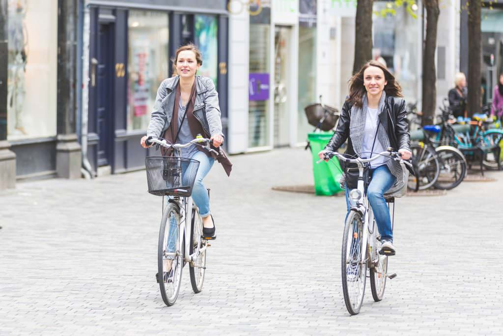 Two cyclists and no cars around