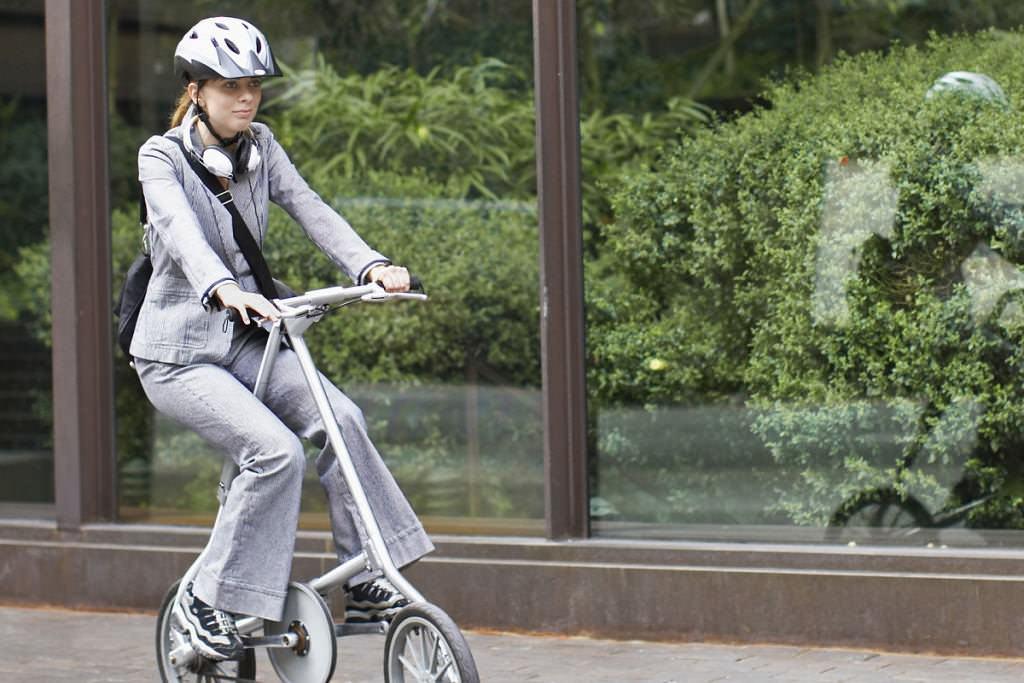 Fashion woman on folding bike