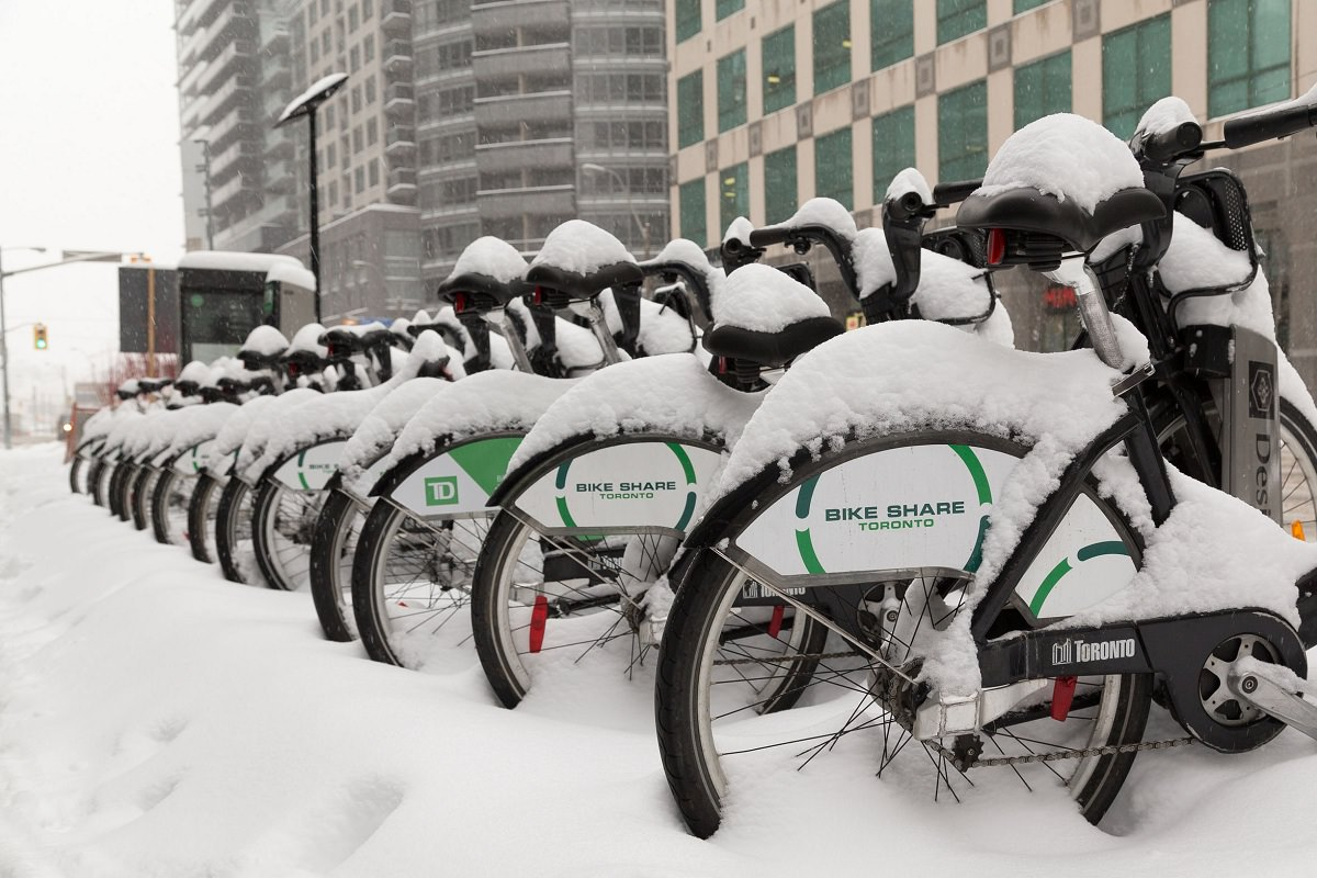 Snow covered bikes with fenders