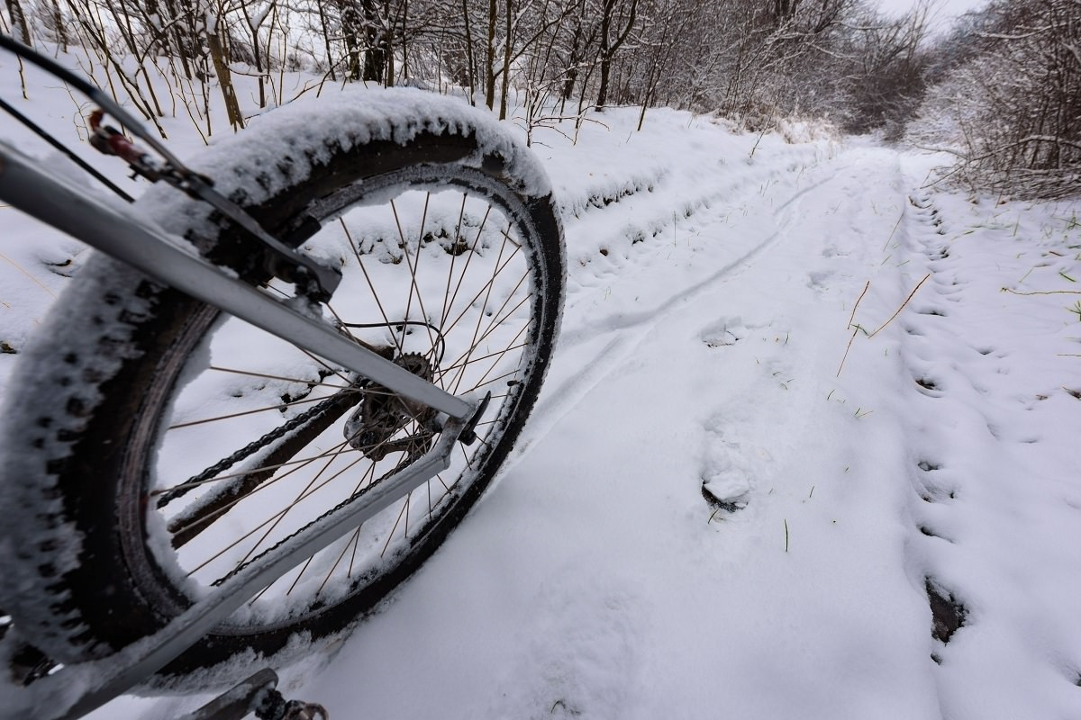 Bike wheel on snowy road