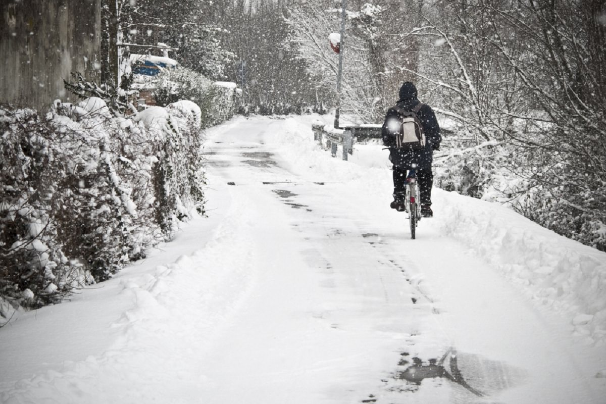 Biking with snowfall around