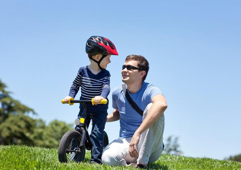 Father and son biking