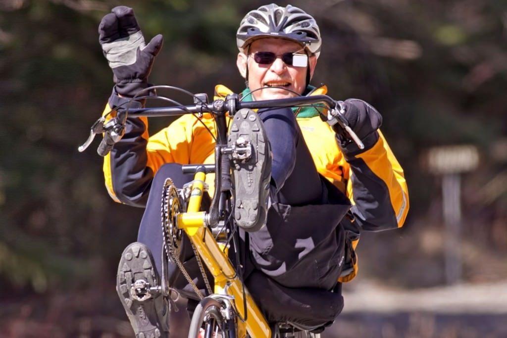 Recumbent rider waving