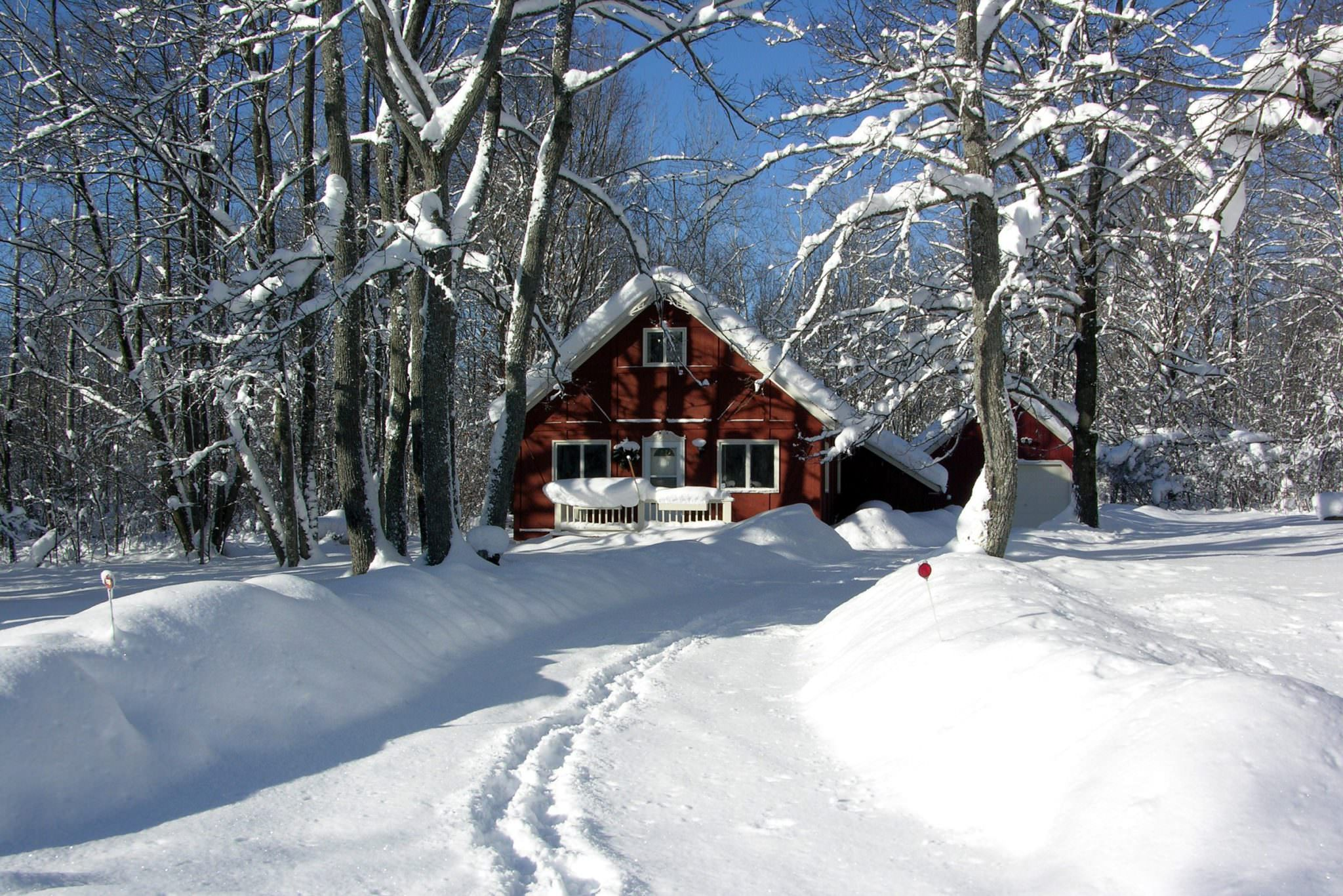 Cottage with snow tracks