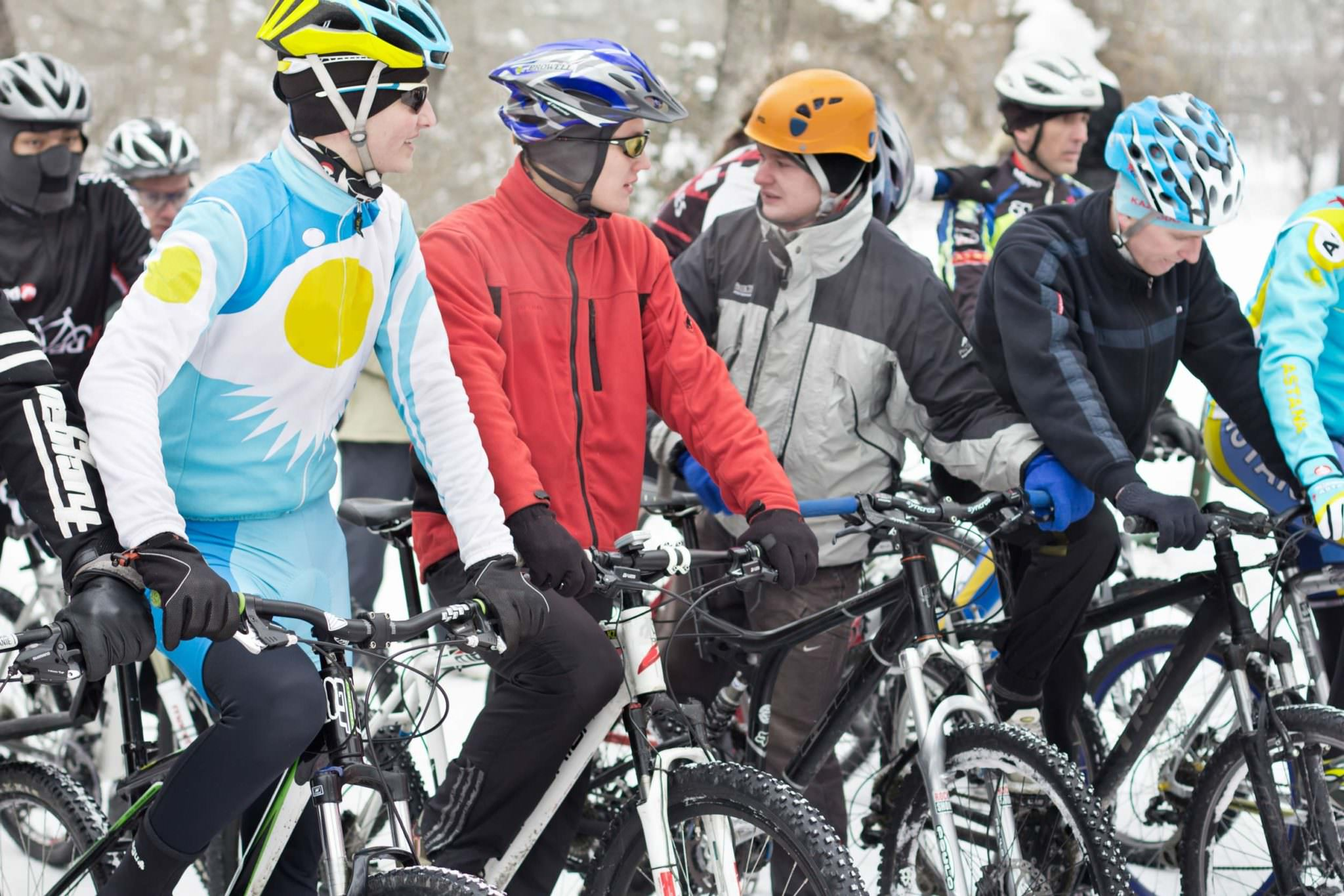 Winter cyclists with different cycling jackets