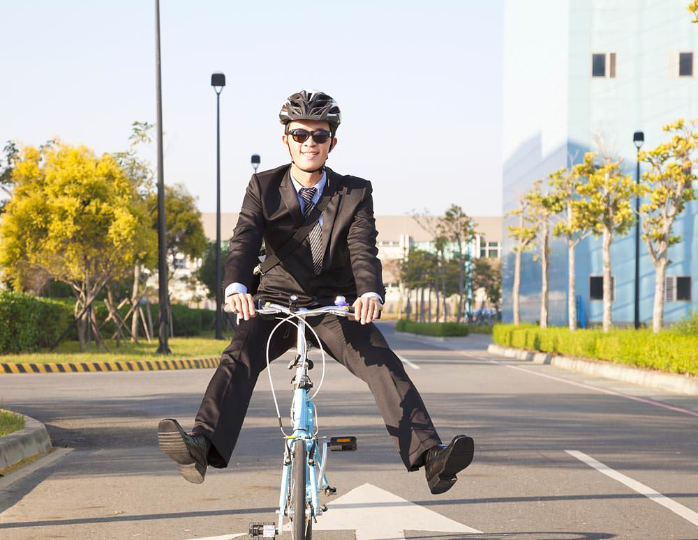 Man riding cycle to office
