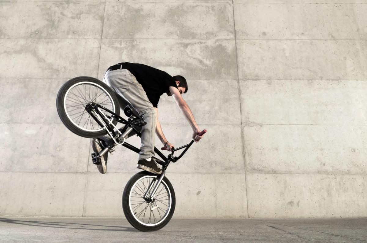 BMX biker with rear wheel up