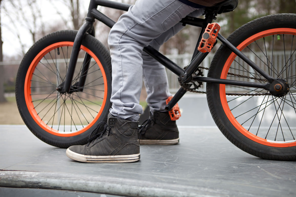 BMX bike rider parked