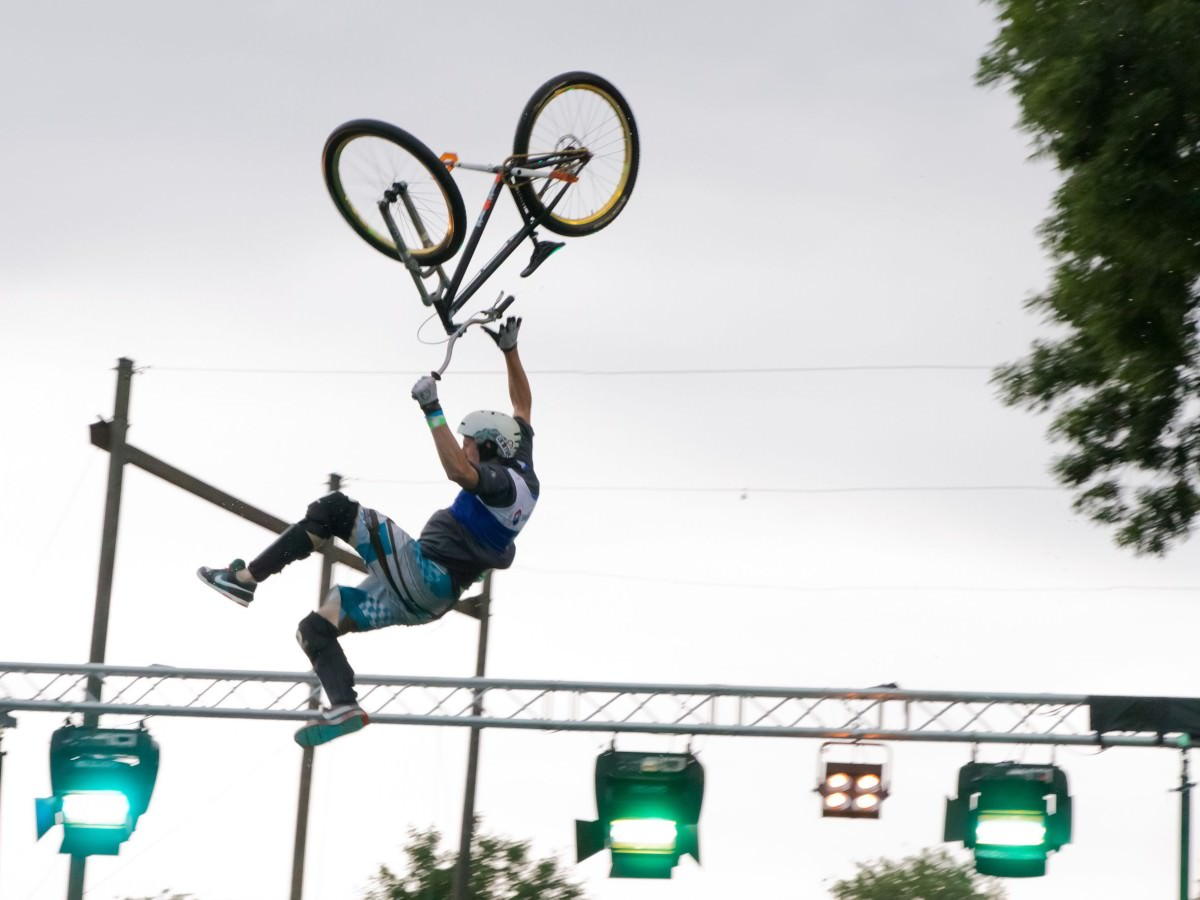 Hanging from the bike after a jump