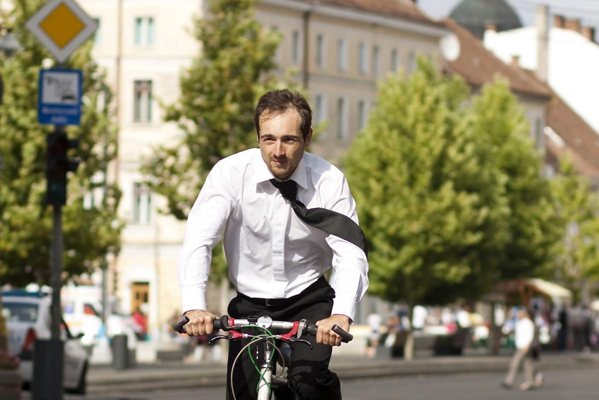 Business man riding bike in the city