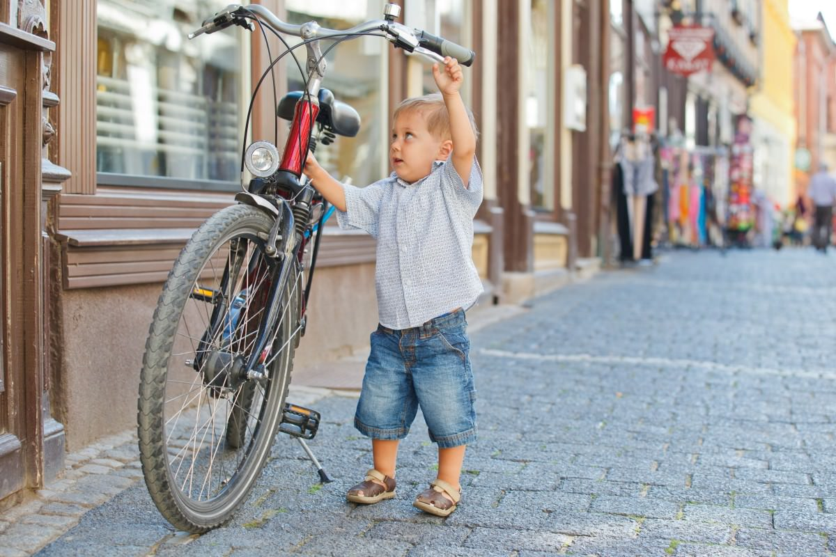Cute little boy with big bike