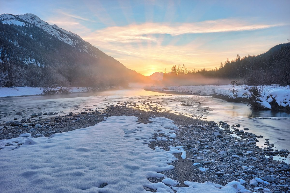 Sunshine on icy river