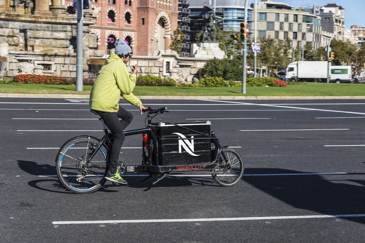 Person riding his bike with cargo box in front