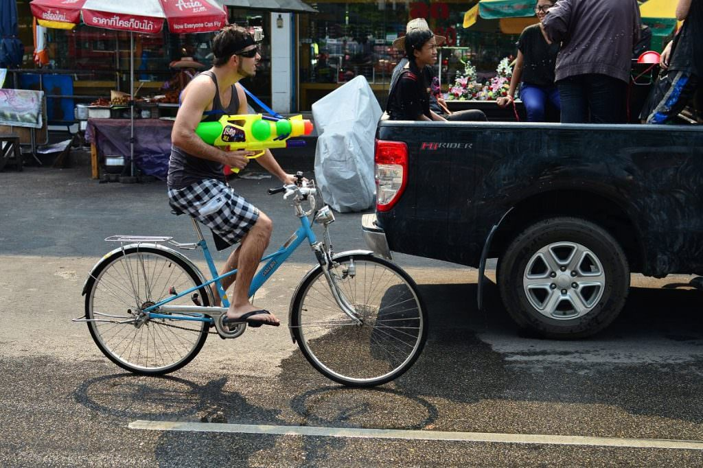 Cyclist with water gun