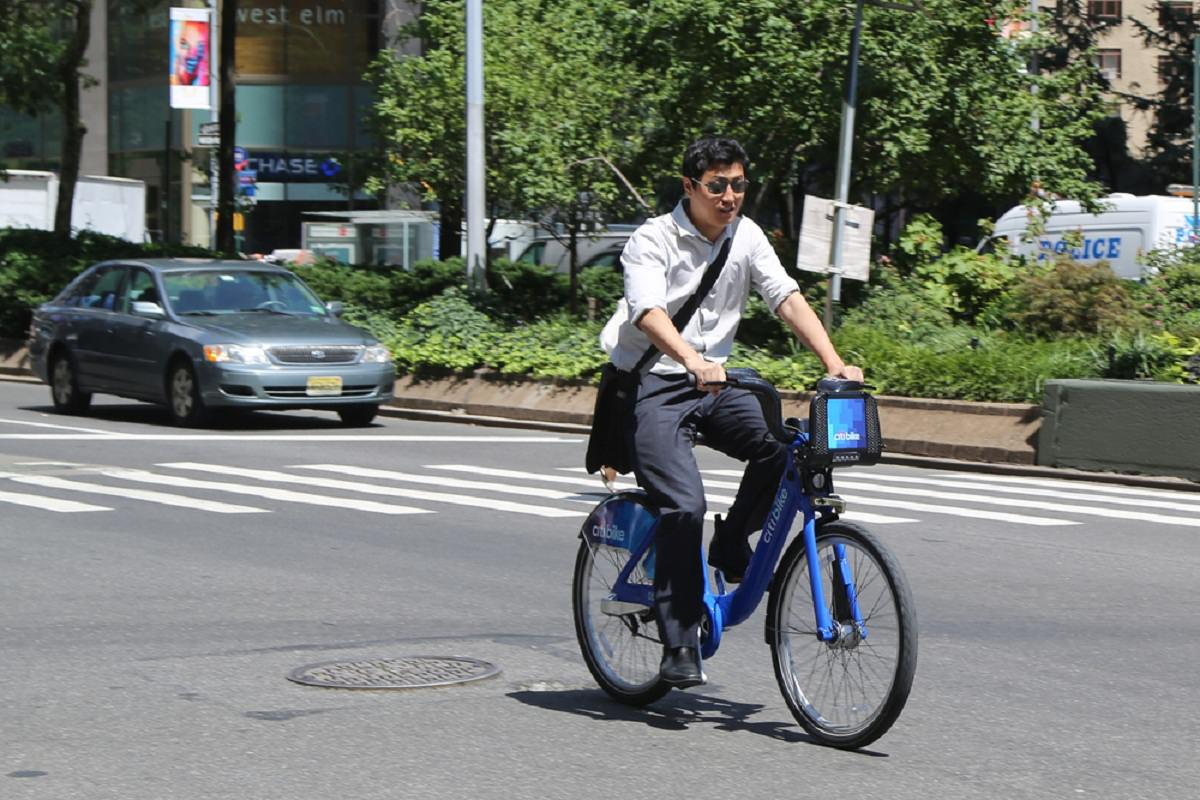 Citi bike rider cycling on road