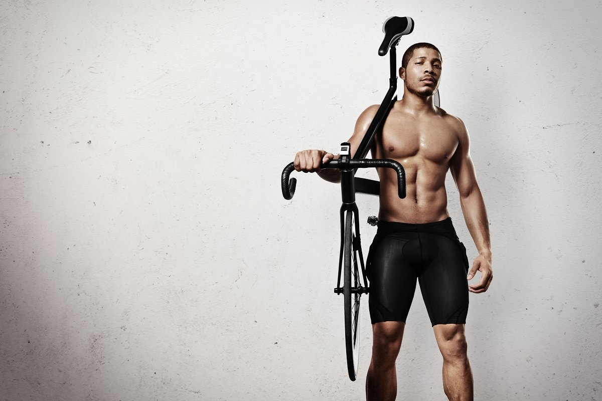 Athelete with bicycle on shoulder