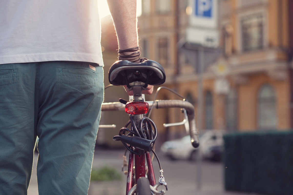 Biker with vintage race bike