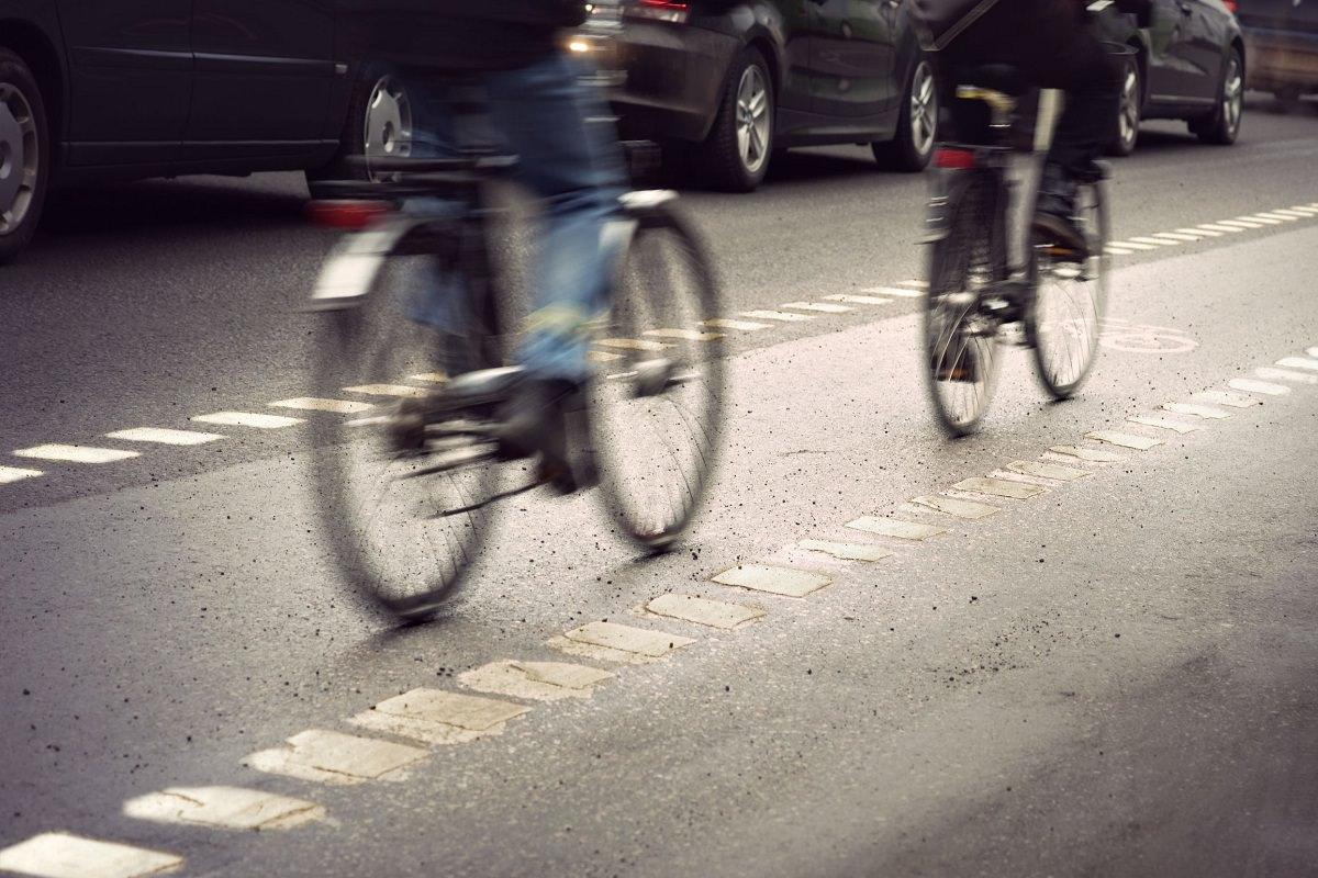 Cyclists biking in bike lane