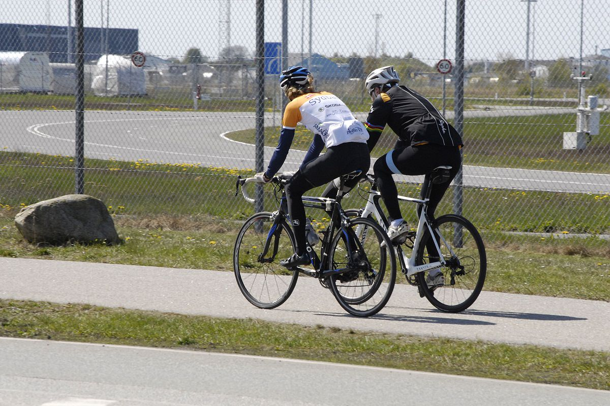 Cyclists riding their bikes together