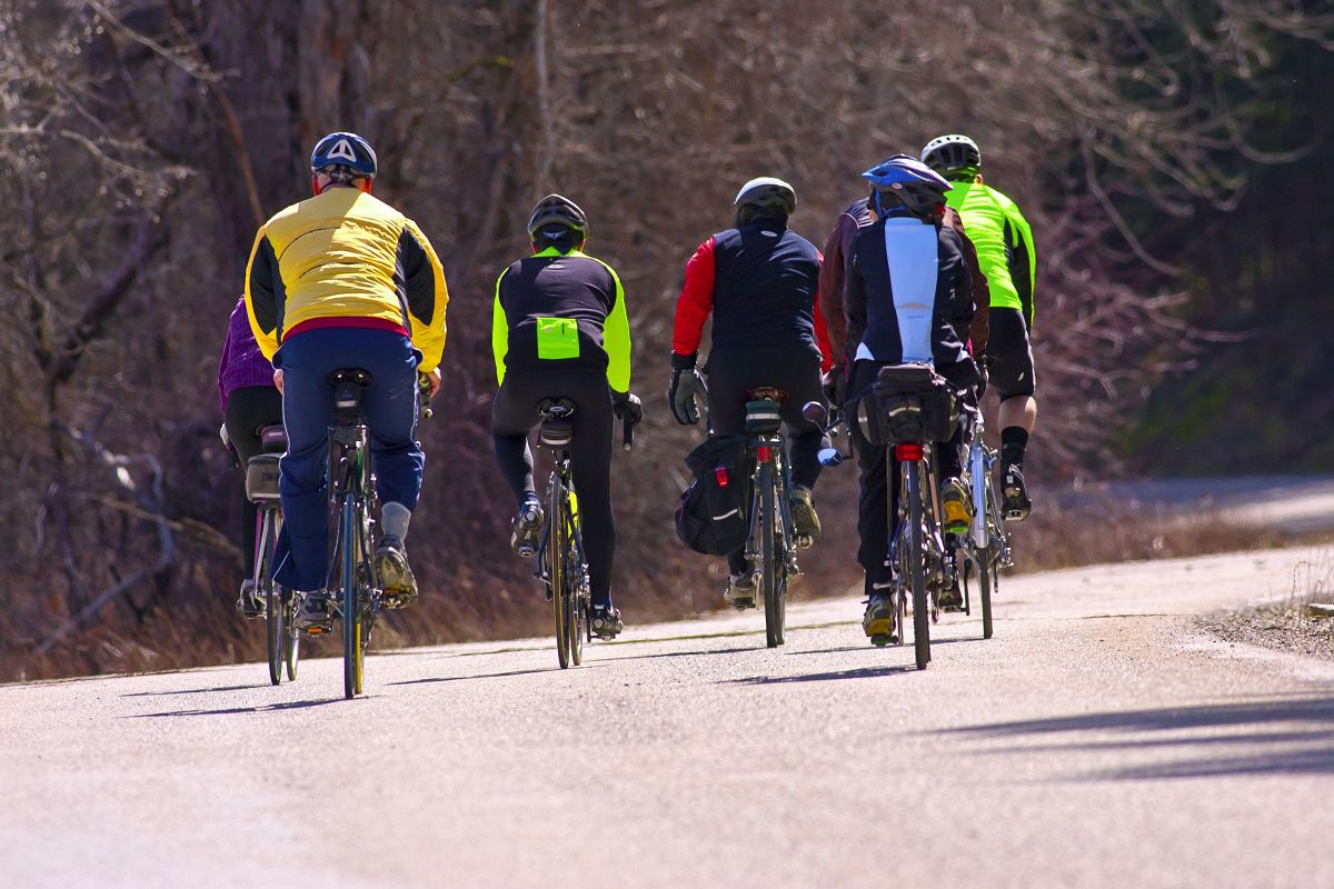 Riders cycling together