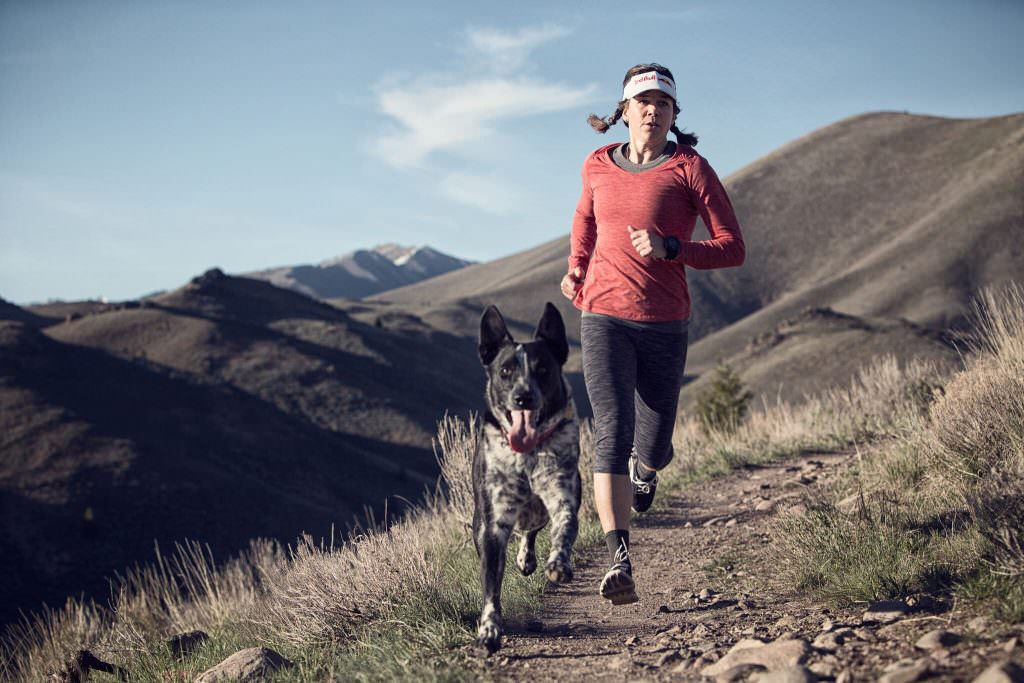 Rebecca Rusch running with her dog