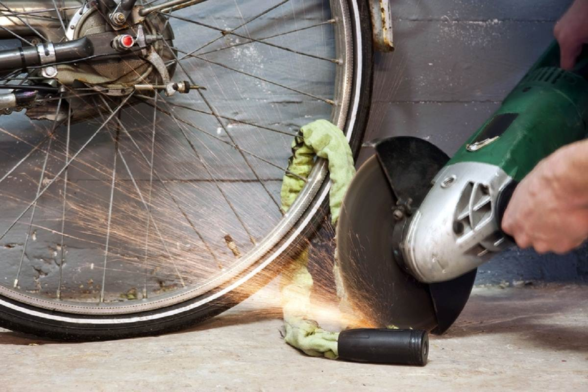 Thief cutting a bike lock with cutter