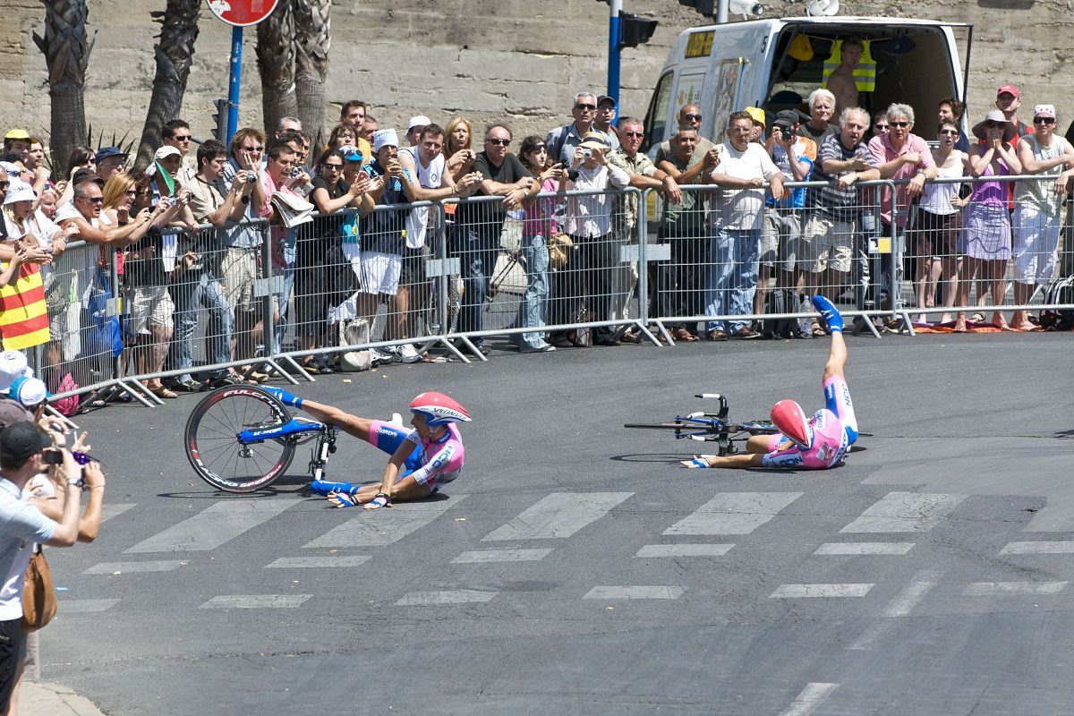 Two riders crash with each other in a race