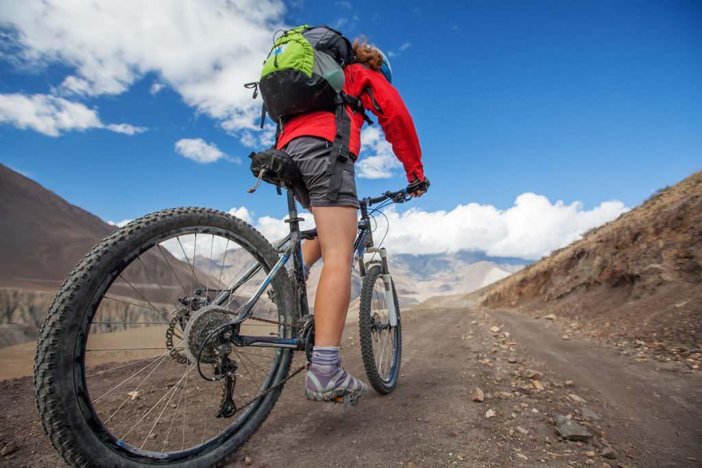 Medic cycling on a mountain bike