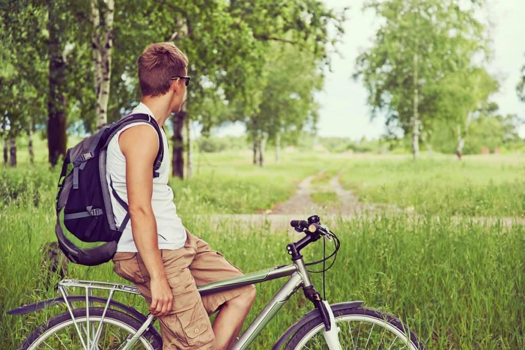 Man on a hybrid bike