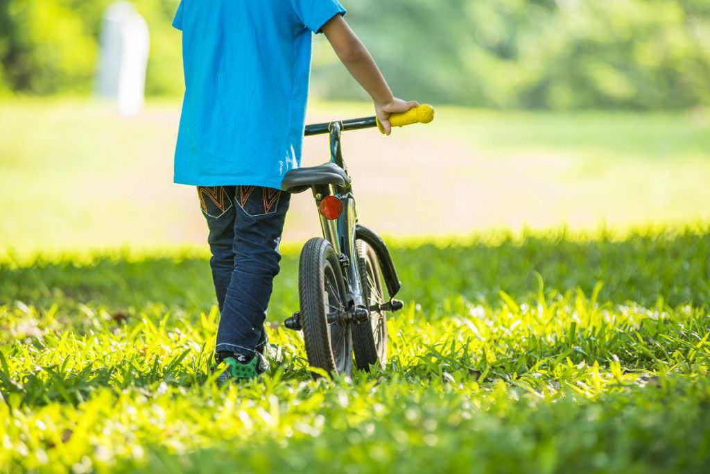 Toddler with his balance bike