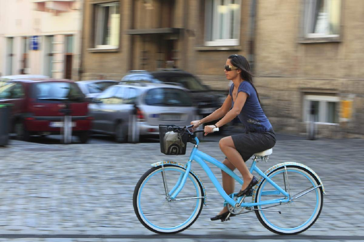 Woman cycling in the city