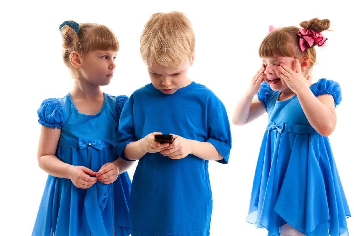 Children fighting on a phone
