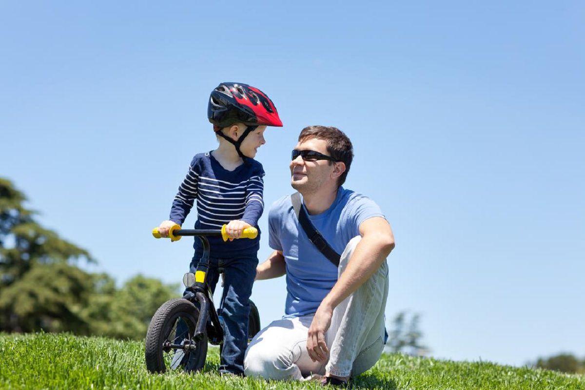 Father and son with a balance bike