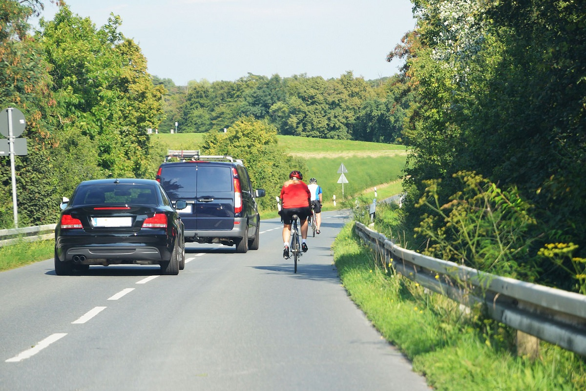 Cyclist passed by cars