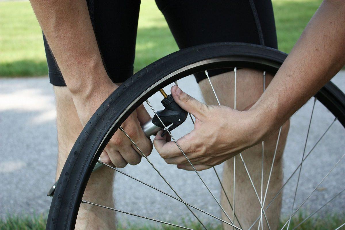 Rider checking tire pressure