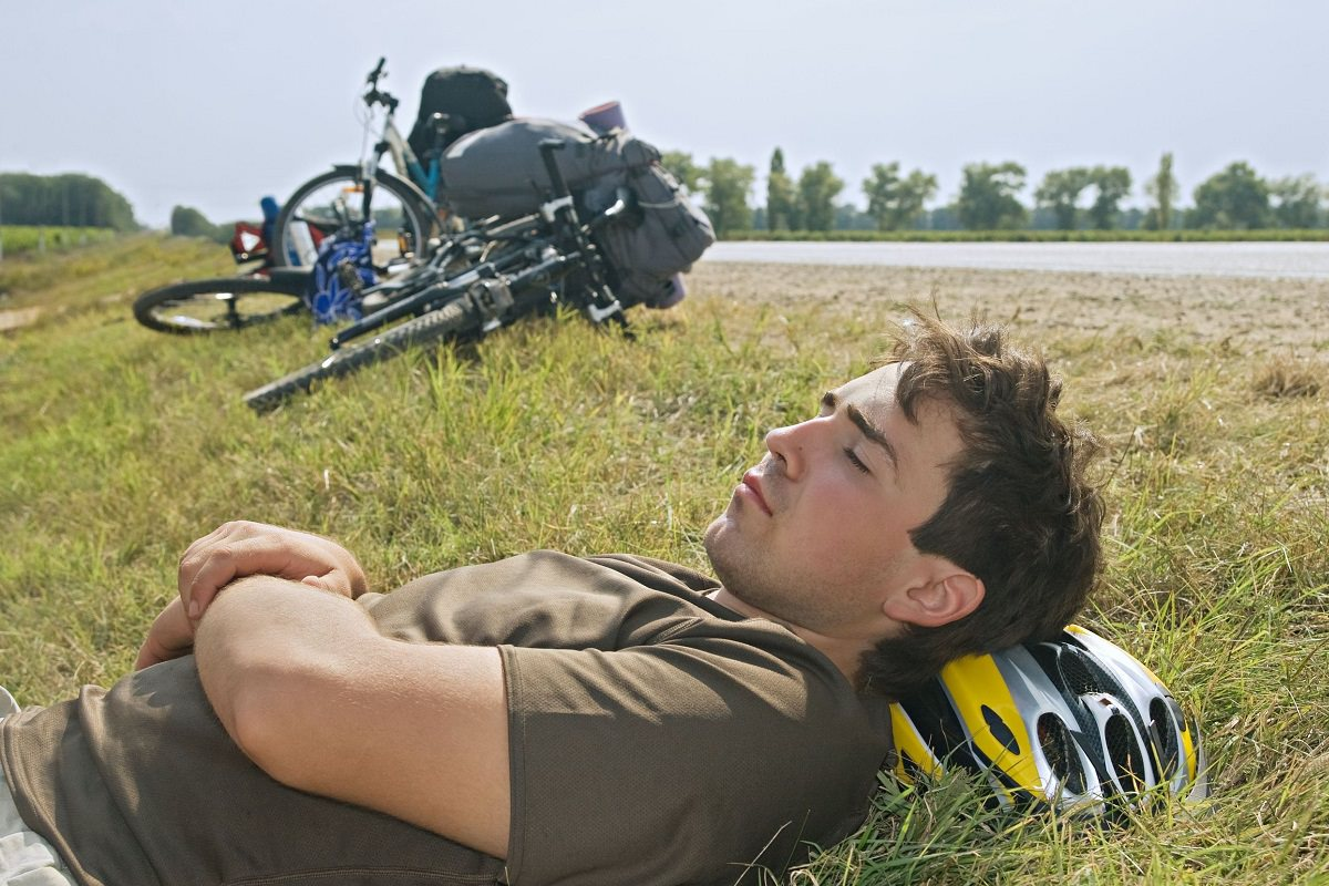 Cyclist resting with eyes closed