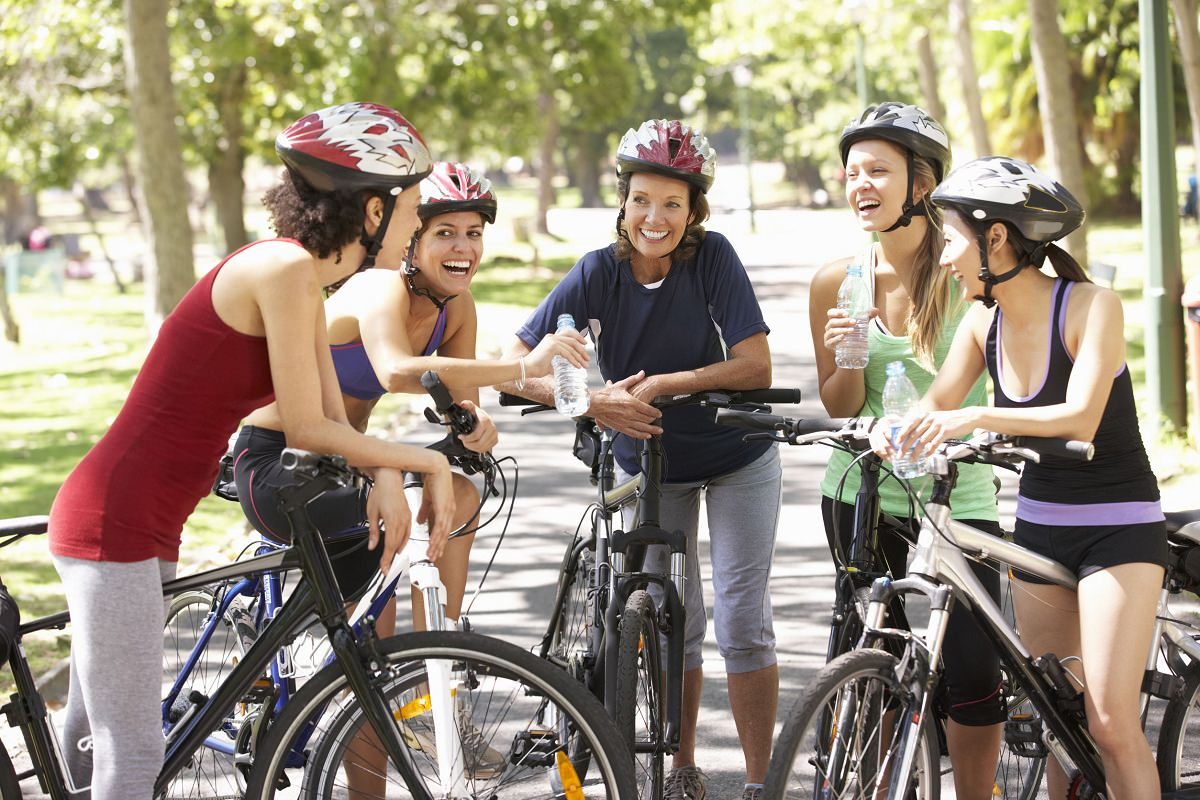 Group of cyclists with bike helmets on