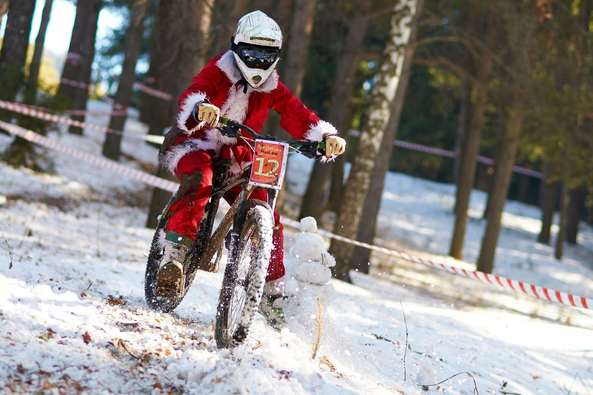 Santa Claus on a mountain bike