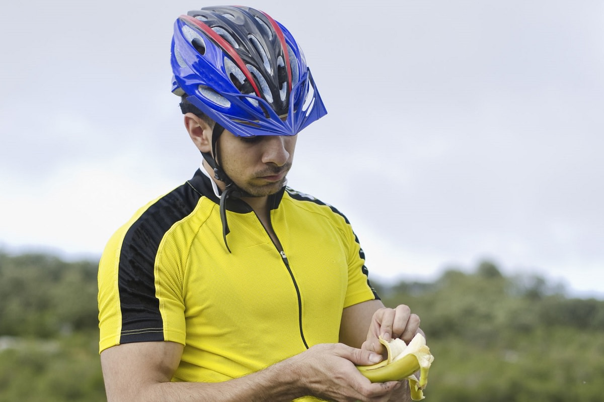 Road biker eating a banana