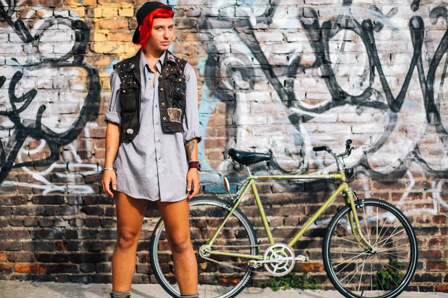 Red haired woman with bike