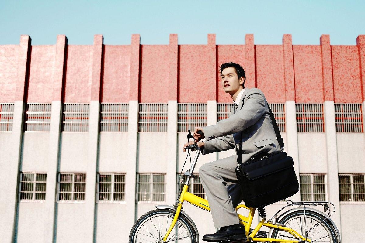 Man on a small bike