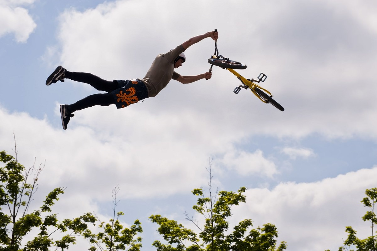 Man flying with his BMX bike