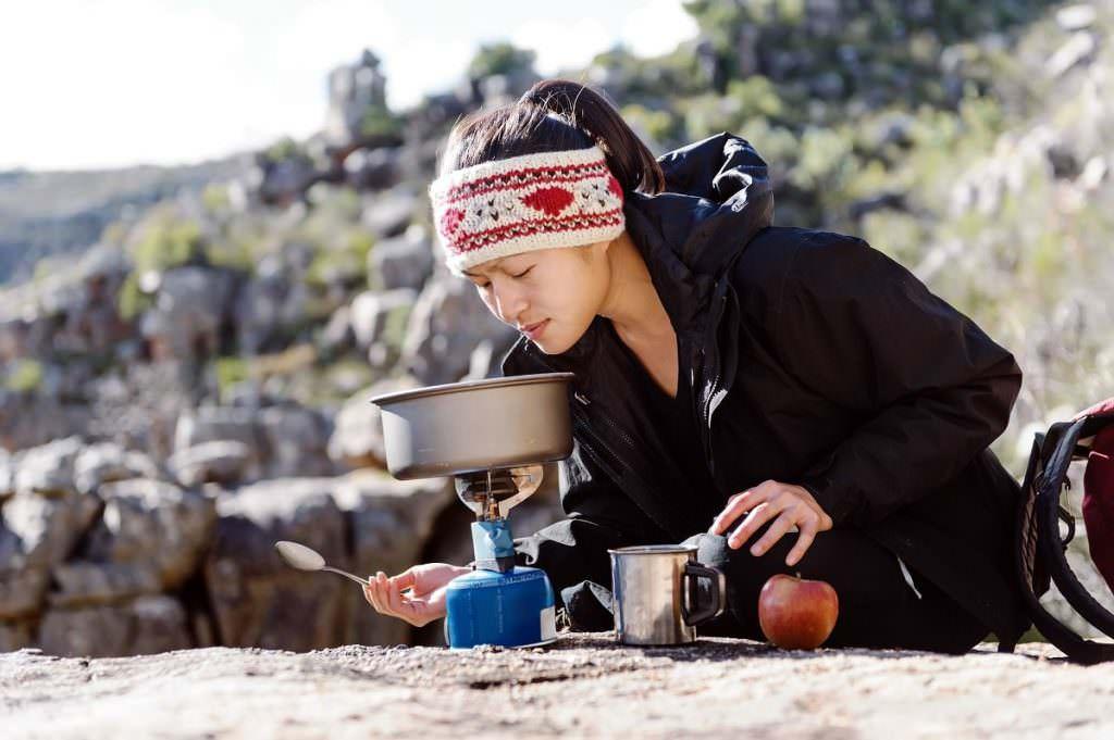 Woman making food outside