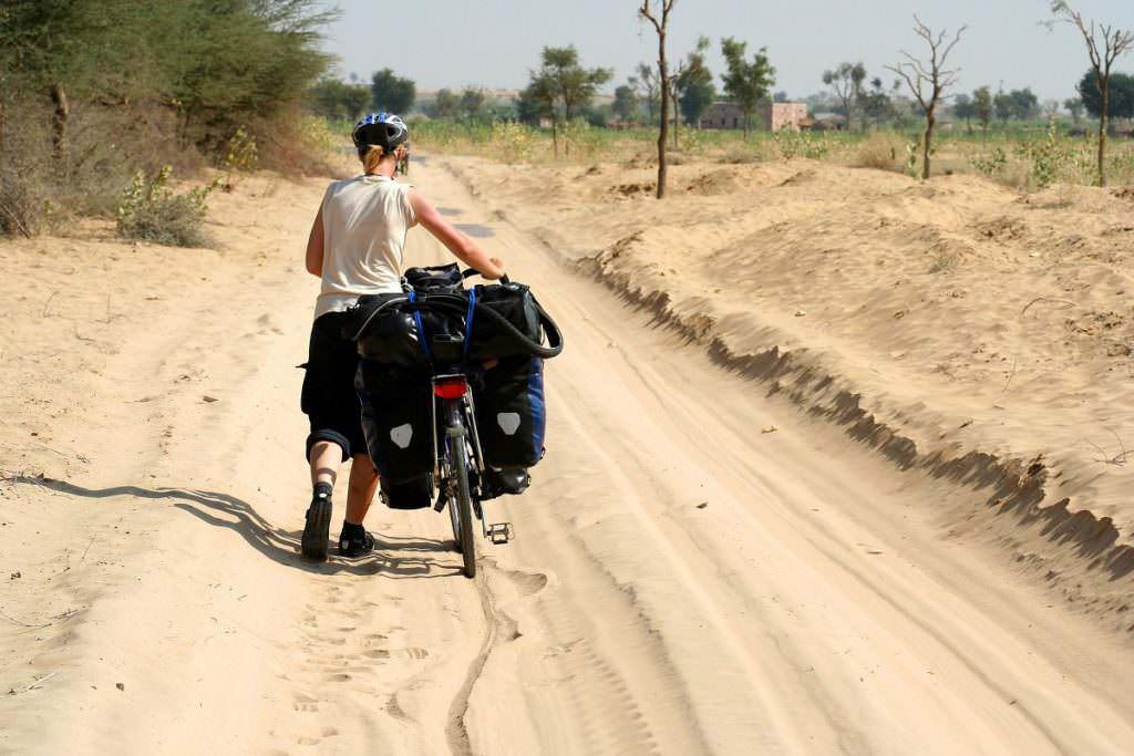 Dragging bike through a desert