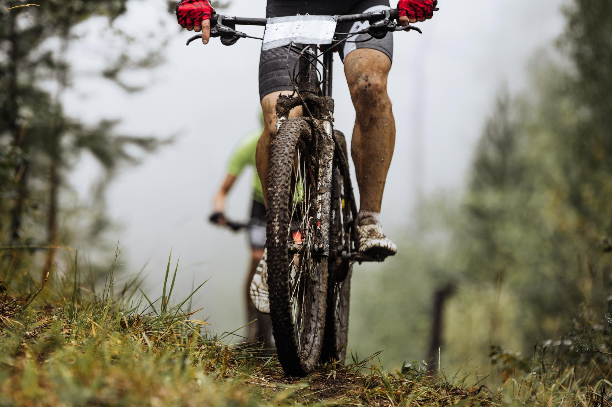 road bike wheels in mud