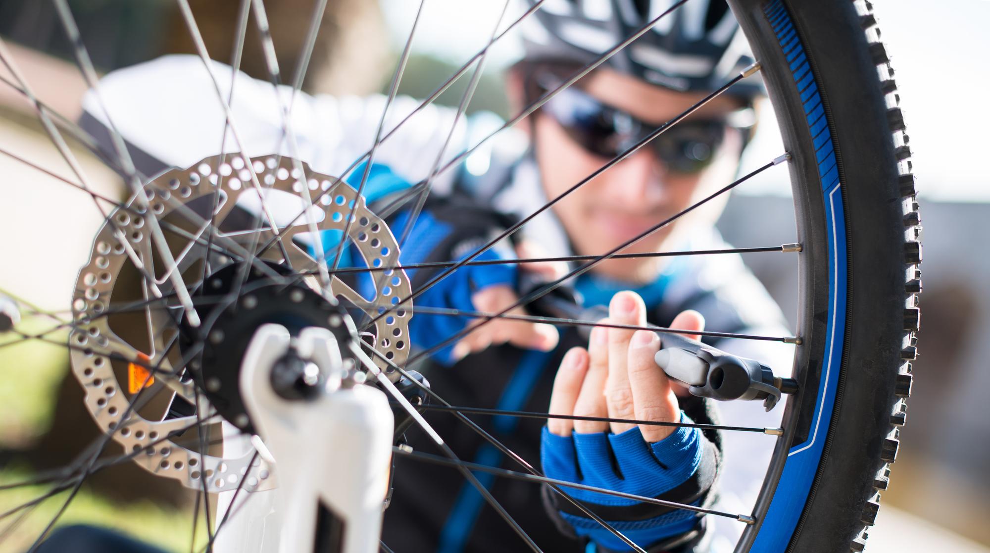 Cyclist preparing his wheels