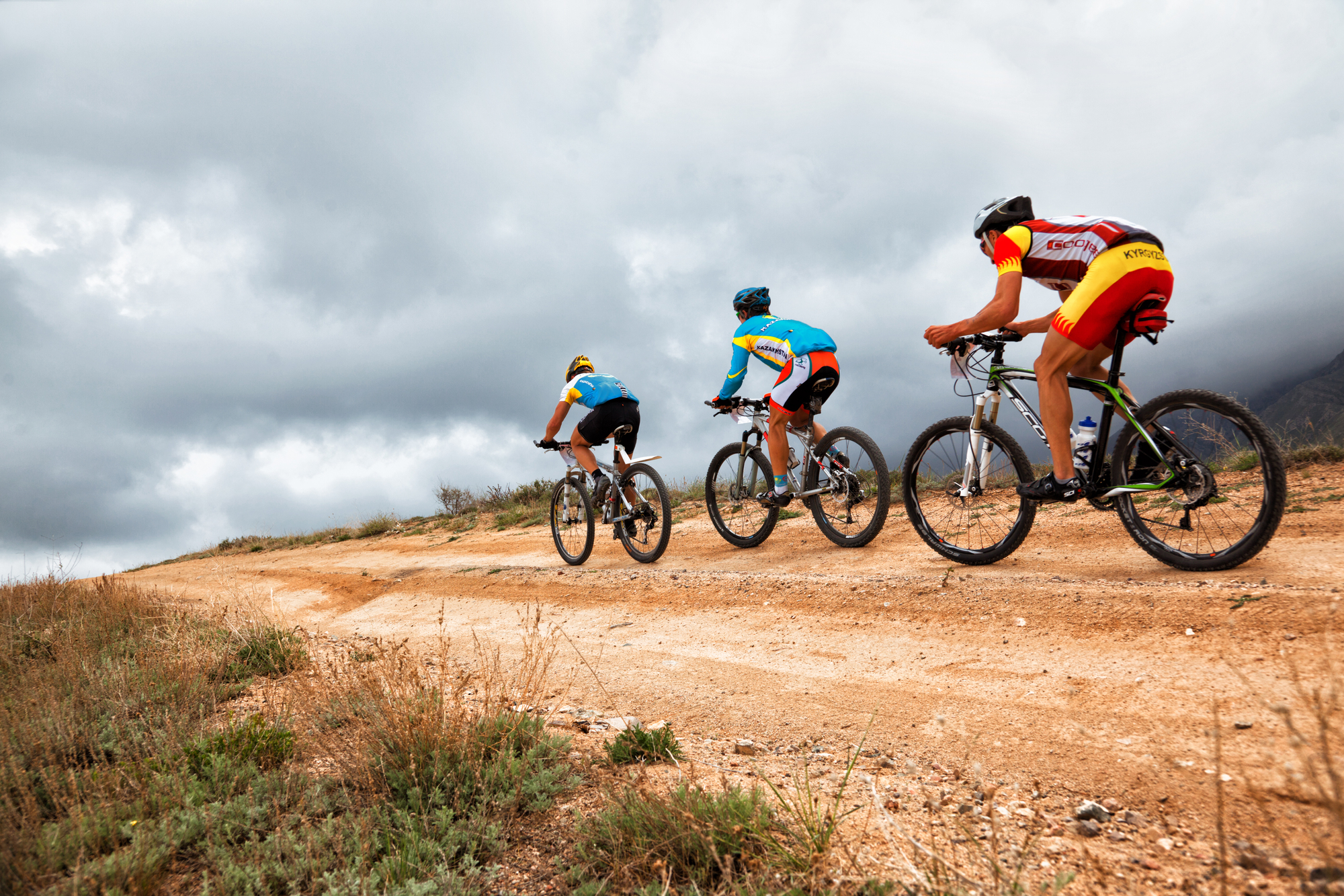 3 cyclists on mountain bikes